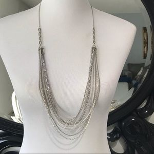 25- multiple strand silver necklace w/ beads and